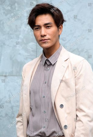 Chinese Actor Chen Kun Poses Before the Presentation of the Fall/winter 2016/2017 Menswear Collection of Italian Designer Giorgio Armani During the Milan Men's Fashion Week in Milan Italy 19 January 2016 the Milano Moda Uomo Runs From 15 to 19 January Italy Milan