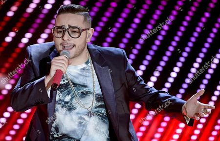Italian Singer Rocco Hunt Performs on Stage During the Sanremo Italian Song Festival at the Ariston Theater in Sanremo Italy 11 February 2016 the 66th Festival Della Canzone Italiana Runs From 09 to 13 February Italy Sanremo