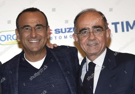 Italian Host Carlo Conti and Rai1 Director Giancarlo Leone (r) Pose During a Photocall Prior a Press Conference One Day After the 66th Festival of the Italian Song of San Remo in Sanremo Italy 14 February 2016 the Closing Ceremony of the 66th Edition of the Television Song Contest Took Place on 13 February Italy Sanremo