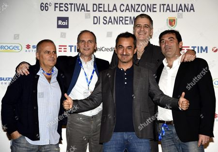 Stock Photo of Italian 'Dopofestival' Cast Nicola Savino (c) Gialappa's Band Members Marco Santin (l) Carlo Taranto (2-l) and Giorgio Gherarducci (2-r) and Max Giusti (r) Pose During a Photocall at the 66th Festival of the Italian Song of San Remo in Sanremo Italy 09 February 2016 the 66th Edition of the Television Song Contest Runs From 09 to 13 February Italy Sanremo