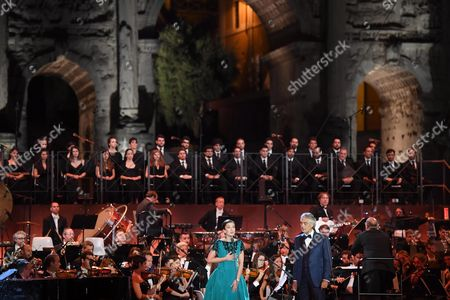 Italian Tenor Andrea Bocelli (c-r) and British Mezzo-soprano Carly Paoli (c-l) Perform During the Concert 'Music For Mercy' with the Roma United Orchestra at the Archaeological Site of the Roman Forum in the Centre of Rome Italy 26 July 2016 the Event Marked the Pope's Jubilee of Mercy Italy Rome