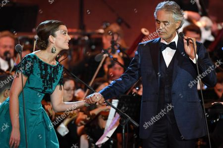 Italian Tenor Andrea Bocelli (r) and British Mezzo-soprano Carly Paoli (l) Perform During the Concert 'Music For Mercy' with the Roma United Orchestra at the Archaeological Site of the Roman Forum in the Centre of Rome Italy 26 July 2016 the Event Marked the Pope's Jubilee of Mercy Italy Rome