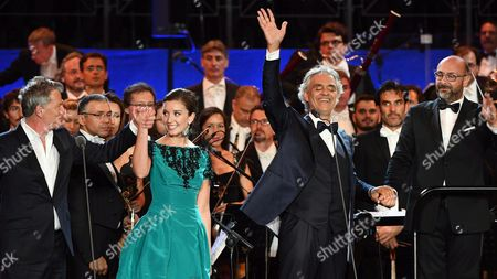 (l-r) Canadian Composer David Foster Italian Tenor Andrea Bocelli British Mezzo-soprano Carly Paoli and Italian Conductor Gianluca Marciano on Stage During the Concert 'Music For Mercy' with the Roma United Orchestra at the Archaeological Site of the Roman Forum in the Centre of Rome Italy 26 July 2016 the Event Marked the Pope's Jubilee of Mercy Italy Rome