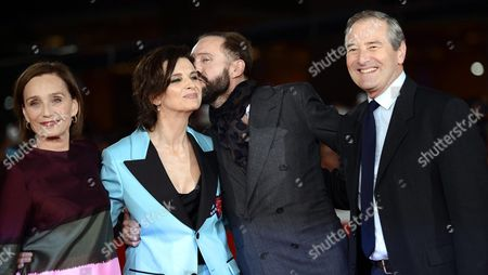Stock Image of (l-r) British Actress Kristin Scott-thomas French Actress Juliette Binoche British Actor Ralph Fiennes and British Actor Julian Wadham Arrive For the Screening of 'The English Patient' at the 11th Annual Rome Film Festival in Rome Italy 22 October 2016 the Film Festival Screened 'The English Patient' Directed by British Filmmaker Anthony Minghella (1954-2008) on the Occasion of 20th Anniversary of the Movie's Release the Festival Runs From 13 to 23 October Italy Rome