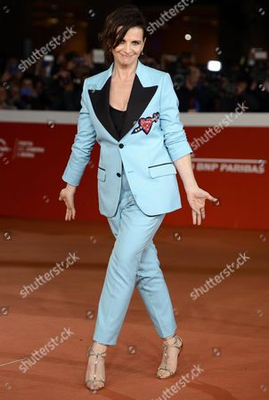 Stock Picture of French Actress/cast Member Juliette Binoche Arrives For the Screening of 'The English Patient' at the 11th Annual Rome Film Festival in Rome Italy 22 October 2016 the Film Festival Screened 'The English Patient' Directed by British Filmmaker Anthony Minghella (1954-2008) on the Occasion of 20th Anniversary of the Movie's Release the Festival Runs From 13 to 23 October Italy Rome