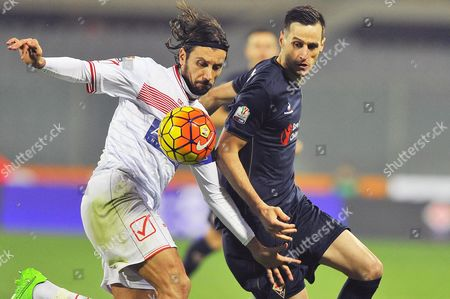 Stock Image of Fiorentina's Forward Nikola Kalinic (r) in Action Against Carpi's Cristian Zaccardo (l) During the Coppa Italia Round of 16 Soccer Match Between Ac Fiorentina and Carpi Fc at Artemio Franchi Stadium in Florence Italy 16 December 2015 Italy Florence