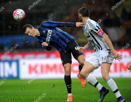 Inter's Ivan Perisic (l) and Juventus' Leonardo Bonucci in Action During the Italian Cup Second Leg Semi Final Soccer Match Between Inter Fc and Juventus Fc at Giuseppe Meazza Stadium in Milan Italy 02 March 2016 Italy Milan