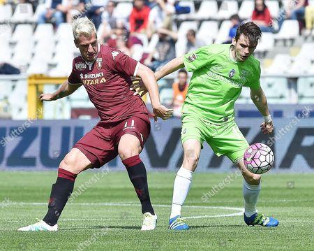 Torino's Maxi Lopez (l) and Atalanta's Marten De Roon in Action During the Italian Serie a Soccer Match Torino Fc Vs Atalanta Bc at Olimpico Stadium in Turin Italy 10 April 2016 Italy Turin