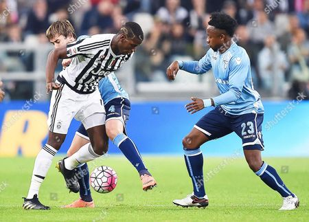 Juventus' Paul Pogba (c) in Action Against Lazio Players Patricio Gabarron Gil (back) and Ogenyi Onazi (r) During the Italian Serie a Soccer Match Between Juventus Fc and Ss Lazio at Juventus Stadium in Turin Italy 20 April 2016 Italy Turin