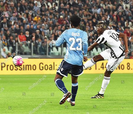 Juventus' Forward Paul Pogba (r) in Action Against Lazio's Ogenyi Onazi (l) During the Italian Serie a Soccer Match Between Juventus Fc and Ss Lazio at Juventus Stadium in Turin Italy 20 April 2016 Italy Turin