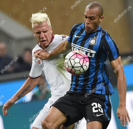 Inter's Defender Joao Miranda (r) Struggles For the Ball with Torino's Forward Maxi Lopez During the Serie a Soccer Match Between Fc Internazionale and Torino Fc at the Giuseppe Meazza Stadium in Milan Italy 3 April 2016 Italy Milan