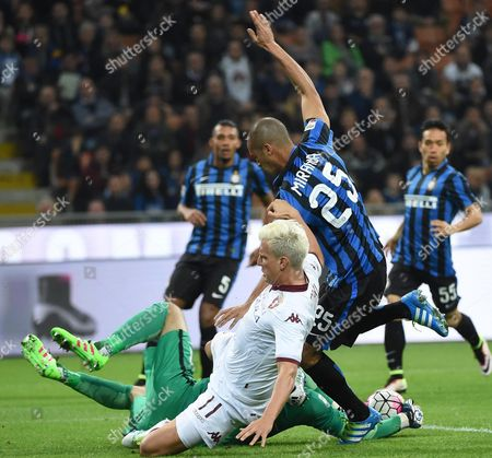 Torino's Forward Maxi Lopez (l) Struggles For the Ball with Inter's Defender Joao Miranda During Their Serie a Soccer Match Fc Internazionale Vs Torino Fc at the Giuseppe Meazza Stadium in Milan Italy 3 April 2016 Italy Milan