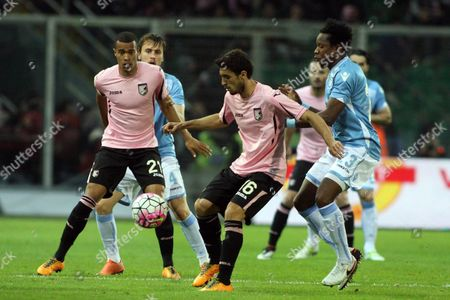 Palermo's Gaston Brugman and Lazio's Ogenyi Onazi in Action During the Italian Serie a Soccer Match Between Palermo and Ss Lazio at Renzo Barbera Stadium in Palermo Italy 10 April 2016 Italy Palermo