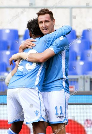 Lazio's Ogenyi Onazi (l) Celebrates with His Teammate Miroslav Klose (r) After Scoring the 2-0 Lead During the Italian Serie a Soccer Match Between Ss Lazio and Empoli Fc at Olimpico Stadium in Rome Italy 17 April 2016 Italy Rome