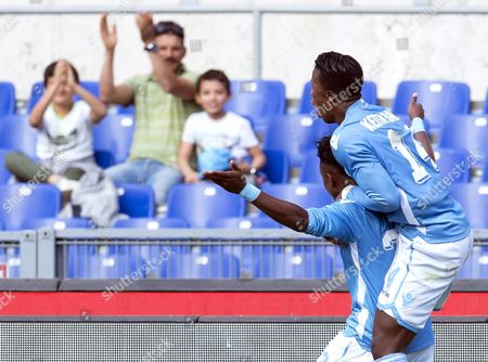 Lazio's Ogenyi Onazi (c) Celebrates with His Teammate Keita Balde Diao (r) After Scoring the 2-0 Lead During the Italian Serie a Soccer Match Between Ss Lazio and Empoli Fc at Olimpico Stadium in Rome Italy 17 April 2016 Italy Rome