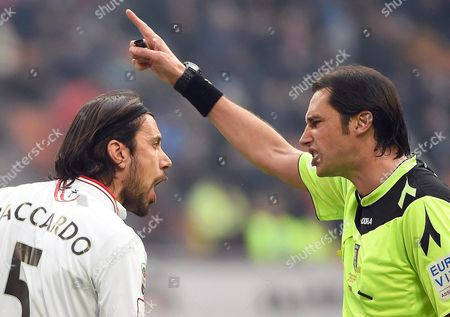 Carpi's Defender Cristian Zaccardo (l) Argues with Referee Andrea Gervasoni (r) During the Italian Serie a Soccer Match Between Inter Milan and Carpi Fc at Giuseppe Meazza Stadium in Milan Italy 24 January 2016 Italy Milan