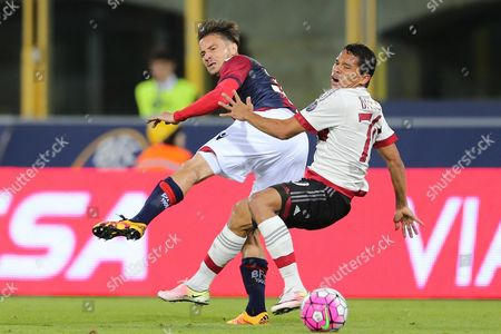 Bologna's Matteo Brighi (l) and Milan's Carlos Bacca in Action During the Italian Serie a Soccer Match Bologna Fc Vs Ac Milan at Dall'ara Stadium in Bologna Italy 07 May 2016 Italy Bologna