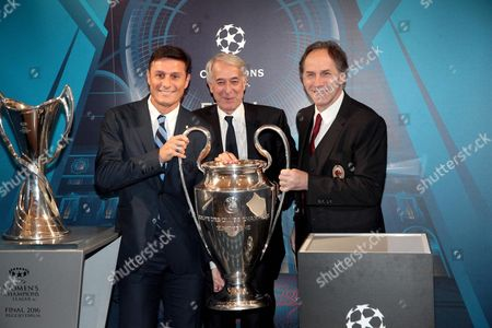 Former Soccer Players Javier Zanetti (l) and Franco Baresi (r) with Milan's Mayor Giuliano Pisapia (c) Pose with the Uefa Champions League Trophy at Palazzo Marino in Milan Italy 22 April 2016 Ahead of the 2016 Final Match on 28 May at the Meazza Stadium in Milan Italy Milan