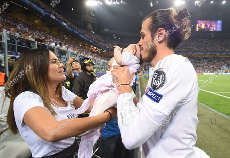 Gareth Bale of Real Madrid Celebrates with His Girlfriend Emma Rhys-jones and Their Daughrer Nava Valentina After Real Madrid Won the Uefa Champions League Final Between Real Madrid and Atletico Madrid at the Giuseppe Meazza Stadium in Milan Italy 28 May 2016 Italy Milan