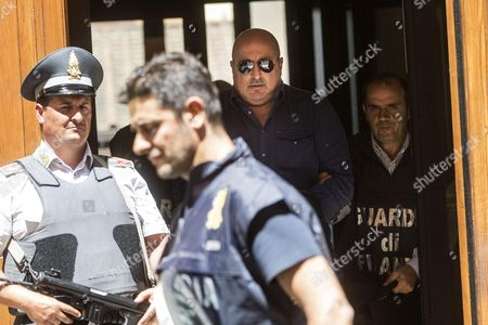 Stock Picture of Mirko Coppola (c) is Escorted by Tax Police out of 'Cadorna' Guardia Di Finanza Station After He Has Arrested in Rome Italy 20 July 2016 Tax Police in Rome Arrested Well Known Entrepreneurs Stefano Ricucci and Mirko Coppola For Allegedly Issuing and Using Invoices For Fake Operations the Fake Invoices Said to Be Worth About One Million Euros Were Allegedly Used by Ricucci to Obtain Liquidity Ricucci 54 a Roman Real Estate Entrepreneur was Arrested in 2006 on Stock Manipulation Charges in Connection with His Bid to Take Over Italian Publisher Rcs Coppola Managed a Number of Firms Owned by Ricucci Italy Rome