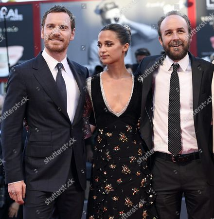 (l-r) German-irish Actor/cast Member Michael Fassbender Swedish Actress/cast Member Alicia Vikander and Us Director Derek Cianfrance Arrive For the Premiere of 'The Light Between Oceans' During the 73rd Annual Venice International Film Festival in Venice Italy 01 September 2016 the Movie is Presented in the Official Competition 'Venezia 73' the Festival Runs From 31 August to 10 September Italy Venice