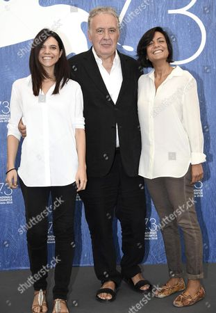 Italian Director and Journalist Michele Santoro (c) Poses with Italian Screenwriters Micaela Farrocco (l) and Maddalena Oliva (r) During a Photocall For His Documentary 'Robinu' at the 73rd Annual Venice International Film Festival in Venice Italy 07 September 2016 the Festival Runs From 31 August to 10 September Italy Venice
