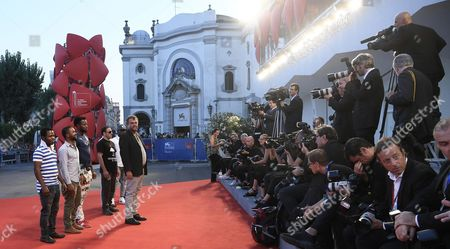 Italia Director Pippo Delbono (c) Arrives with Refugees of the 'Centro Di Villa Quaglina Di Asti' For the Presentation of 'Vangelo' at the 73rd Annual Venice International Film Festival in Venice Italy 08 September 2016 the Festival Runs From 31 August to 10 September Italy Venice