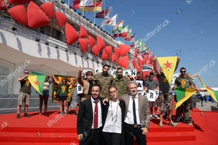(front L-r) Italian Directors Bruno Chiaravallotti Benedetta Argentieri and Claudio Jampaglia Pose with Western Foreign Fighters Against the Self-proclaimed Islamic State (is) (rear L-r) Us Joshua Bell Italian Karim Franceschi and Swedish Rafael Kardari and Kurdish Demonstrators As They Arrive For the Premiere of the Documentary 'Our War' at the 73rd Annual Venice International Film Festival in Venice Italy 09 September 2016 the Festival Runs From 31 August to 10 September Italy Venice