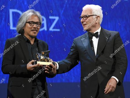 Filipino Film Maker Lav Diaz (l) Holds the Golden Lion Award For His Movie 'Ang Babaeng Humayo' (the Woman who Left) with Biennale President Paolo Baratta (r) During the Awarding Ceremony of the 73rd Annual Venice International Film Festival in Venice Italy 10 September 2016 the Festival Runs From 31 August to 10 September Italy Venice