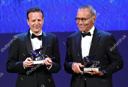 Mexican Film Director Producer and Screenwriter Amat Escalante (l) Holds the Silver Lion Award For His Movie 'La Region Salvaje' (the Untamed) and Russian Director Andrei Konchalovsky (r) Holds the Silver Lion Award For His Movie 'Paradise' During the Awarding Ceremony of the 73rd Annual Venice International Film Festival in Venice Italy 10 September 2016 the Two Directors Won the Silver Lion Award Ex Aequo the Festival Runs From 31 August to 10 September Italy Venice