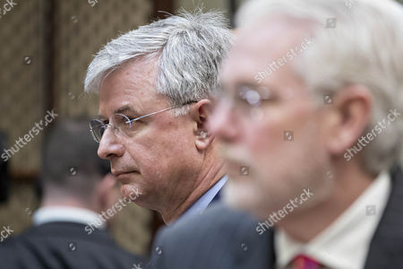Stock Photo of Hubert Joly, chairman, president and chief executive officer of Best Buy Co., left, and William Rhodes III, chief executive officer of AutoZone Inc., wait to begin a listening session with U.S. President Trump, not pictured, and Retail Industry Leaders Association and member company chief executive officers in the Roosevelt Room of the White House in Washington, D.C., U.S.,. Questions about ties between Trump's team and Russian intelligence agents mounted Wednesday after new reports of extensive contacts between the two, which are sure to fuel Republican calls for a deeper look at Trump's links to the country.
