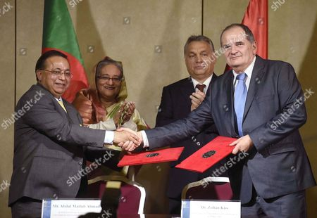 The President of the Bangladeshi Chamber of Commerce and Industry Abdul Matlub Ahmad (l) and Vice President of the Hungarian Chamber of Commerce and Industry Zoltan Kiss (r) Shake Hands After Signing a Memorandum of Understanding Between Their Respective Ministries As Bangladesh Prime Minister Sheikh Hasina Wazed (l-rear) and Hungarian Prime Minister Viktor Orban (r-rear) Watch on in the Delegation Room of the Parliament Building in Budapest Hungary 29 November 2016 Hungary Budapest