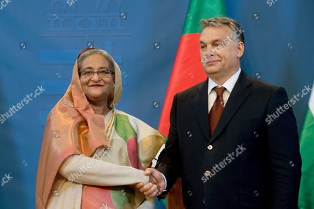 Hungarian Prime Minister Viktor Orban (r) and Bangladeshi Prime Minister Sheikh Hasina Wazed Shake Hands During a Joint Press Conference Held After Their Meeting in the Delegation Room of the Parliament Building in Budapest Hungary 28 November 2016 Sheikh Hasina Wazed is the First Premier of Bangladesh to Pay an Official Visit to Hungary Hungary Budapest