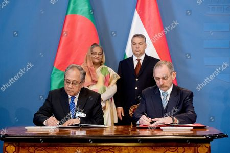Stock Picture of Hungarian Interior Minister Sandor Pinter (r) and Minister For Water Resources of Bangladesh Anisul Islam Mahmud (r) Sign a Memorandum of Understanding Between Their Respective Ministries Regarding Their Cooperation on Water Management in the Presence of Bangladesh Prime Minister Sheikh Hasina Wazed (2l) and Hungarian Prime Minister Viktor Orban (r2) in the Delegation Room of the Parliament Building in Budapest Hungary 29 November 2016 Hungary Budapest