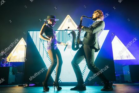 Singer Cleo Panther (l) and Saxophonist Markus Ecklmayr of the Austrian Parov Stelar Band Perform During the Mvm Winter Magic Charity Concert at the Papp Laszlo Sports Arena in Budapest Hungary 28 November 2016 Hungary Budapest