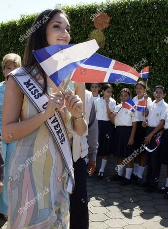 Miss Universe 2003 Dominican Amelia Vega Waves the Dominican Flag (r) and the Nicaraguan Flag (l) on Friday 27 February 2004 at Her Arrival to Visit the Orphan Children From the S O S Hamlet in Managua Nicaragua Miss Universe Will Attend 28 February the Miss Nicaragua Pageant to Be Held at the Ruben Dario National Theatre in Managua Nicaragua Managua