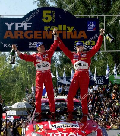 Finland's Marcus Gronholm (r) and Co-driver Timo Rautainen (l) Celebrate Their Victory in the Xxiii Argentine Rally in Villa Carlos Paz Cordoba Some 800 Kilometers North of Buenos Aires Sunday 11 May 2003 Gronholm and Rautianen Driving a Peugeot 206 Won the Race Ahead of Spain's Carlos Sainz and Britain Richard Burns Epa Photo Efe Raul Bellido Argentina Villa Carlos Paz