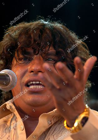 Stock Image of Pakistani Faiz Ali Faiz Qawwali Music Performer During the Presentation of His Show at Culture's Forum 2004 in Barcelona Northeastern Spain on Monday 12 July 2004 Qawwali is a Musical Way of Heterodox Islam Widespread in India and Pakistan Spain Barcelona