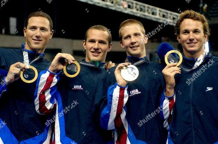 Usa Swimmers of the 4x100 Metres Men Medley Relay Team (from L) Jason Lezak Brendan Hansen Ian Crokcer and Aaron Peirsol Hold Up Their Gold Medal on the Podium of the 4x100 Metres Men Medley Relay Competition at the 10th Fina World Swimming Championship in Barcelona Sunday 27 July 2003 the United States Won the 4x100 Metres Medley Relay Gold Medal at the Swimming World Championships with a World Record 3 Minutes 31 54 Seconds on Sunday Alexander Popov Anchored Russia to Silver in a European Record 3:34 72 and Japan Took Bronze with 3:36 12 Minutes Epa Photo/efe/lavandeira Jr Spain Barcelona