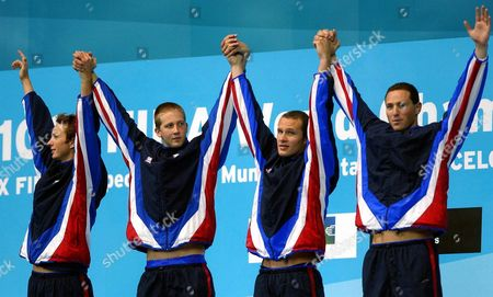 Usa Swimmers of the 4x100 Metres Men Medley Relay Team (from L) Jason Lezak Brendan Hansen Ian Crocker and Aaron Peirsol Raise Their Arms on the Podium of the 4x100 Metres Men Medley Relay Competition at the 10th Fina World Swimming Championship in Barcelona Sunday 27 July 2003 the United States Won the 4x100 Metres Medley Relay Gold Medal at the Swimming World Championships with a World Record 3 Minutes 31 54 Seconds on Sunday Alexander Popov Anchored Russia to Silver in a European Record 3:34 72 and Japan Took Bronze with 3:36 12 Minutes Epa Photo/efe/lavandeira Jr Spain Barcelona