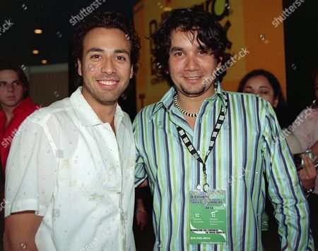 Back Street Boys American Singer Howie (l) and Bacilos' Singer Jorge Villamizar (r) Pose For Photos During the Latin Billboard Music Conference in Miami Wednesday 07 May 2003 in the Conference Singers and Composers Feature Their Songs While Critics Give Their Opinion and Contribute with New Ideas Epa Photo Efe/marimer Codina United States Miami