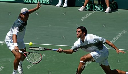 Paraguayan Tennis Player Paulo Carvallo (l) and His Partner Ramon Delgado (r) Returns the Ball Against Their Venezuelan Opponents Jimmy Szymanski and Jose De Armas During the Doubles Match on the Second Day of the Davis Cup Tournament in Caracas on Saturday 07 February 2004 Paraguay Won the Match 3-6 7-6 2-6 6-4 6-3 Paraguay Leads Venezuela 2-1 in the Tie Epa/chico Sßnchez Venezuela Caracas