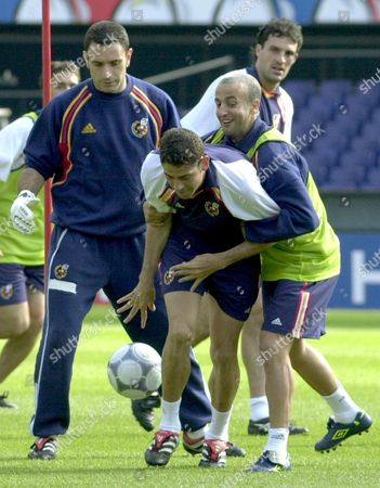 Stock Picture of Step00061256626a Electronic Camera Rot07 - 20000612 - Rotterdam Netherlands : (l-r) Spanish National Team Players Jos Francisco Molina Fernando Hierro and Francisco Javier Gonzlez Prez 'Fran' Joke During a Training Session at the Feyenoord's Stadium in Rotterdam Monday 12 June 2000 to Get Fit For Tomorrow's Euro 2000 Group C Match Against Norway (electronic Camera) Epa Photo Efe/juan Carlos Cardenas/re-hh Netherlands Rotterdam