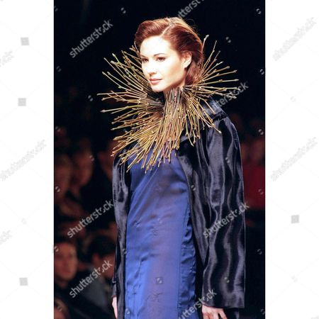 Md23-19980213-madrid Spain: Spanish Model Juncal Rivero Wears a Silk Length Dress and Matching Coat in Blue Colours with a Collar Made Plant Stems As a Creation of Spanish Stylists Torino and Mendoza During the Presentation of Their Autunm-winter 1998-99 Collection at the Pasarela Cibeles Fashion Week in Madrid 13 February 1998 Epa Photo Efe/ramon Castro/gb/kr Spain Madrid
