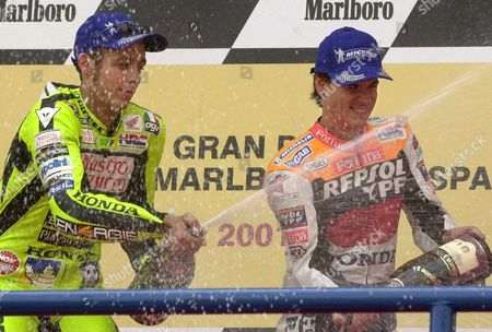 Jer13 - 20010506 - Jerez Andalucia Spain: Valentino Rossi (l) of Italy and Spaniard Alex Criville (r) Spray Champagne on the Podium After the 500cc Spanish Motorcycle Grand Prix Jerez Spain on Sunday 06 May 2001 Rossi Won the Event Ahead of Runner-up Japanese Norik Abe and Alex Criville Epa Photo Efe/jaro Munoz/re-fob Spain Jerez