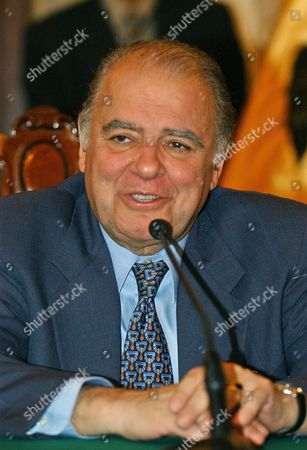 Stock Photo of President of the Inter-american Development Bank (bid) Enrique Iglesias Smiles During His Meeting with the Mayor of Lima Luis Castaneda Lossio on Tuesday 23 March 2004 at the Municipal Palace in the Main Square of Lima Peru the Meeting was Held to Discuss the Celebration of the General Assembly For the Bid Governors to Be Held From March 29 Through March 31 in Lima Peru Lima