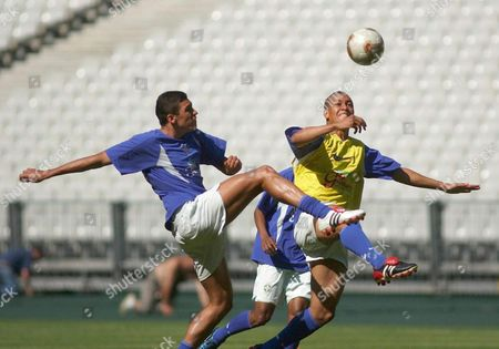 Stock Photo of Brazilian Midfielders Lucimar Da Silva 'Lucio'(l) and 'Eduardo' Nascimento Costa (r) Leap For the Ball During a Team Practice Session of the Brazilian Soccer Team on Monday 16 June 2003 at Stade De France in Paris Brazil Will Face Cameroon on June 19 For the Confederations Cup Epa Photo/efe/felipe Marcel France Paris