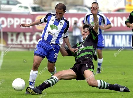 Ma01 - 20000520 - Malaga Spain : Spanish Soccer Player Ismael Ruiz (r) of Racing De Santander Tries to Stop Carlos Sierra 'Sandro' (l) of Mlaga During Their Primera Division Match Saturday 20 May 2000 in La Rosaleda Stadium in Malaga ***electronic Image*** Epa Photo Efe/rafael Diaz/ell-hh Spain Malaga