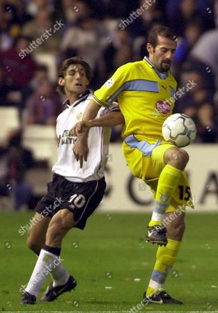 V09-20000405-valencia Spain: Lazio's Player Giuseppe Pancaro (r) Fights For the Ball with Valencia's Player Miguel Angel Angulo (l) During Their Uefa Champions League Quarterfinal Match at Mestalla Stadium in Valencia Wednesday 05 March 2000 Valencia Won the Match 5-2 (digital Image) Epa Photo/efe/j C Cardenas/sbf-hh Spain Valencia