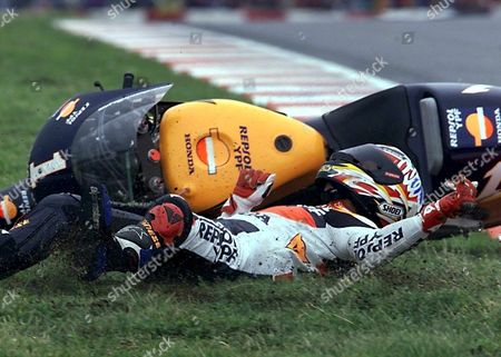 Bar15-20000611-barcelona Spain: Spanish 500cc Driver Alex Criville with Honda After Crashing During a Catalan Motorcycling Grand Prix at Montmelo Circuit Near Barcelona on Sunday 10 June 2000 (electronic Image) Epa Photo Efe/lluis Gene Spain Barcelona